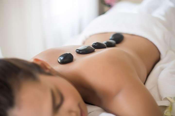 Stone massage woman